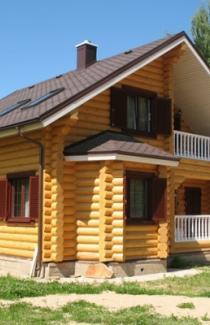 Изготовление деревянного дома из оцилиндрованного бруса под ключ